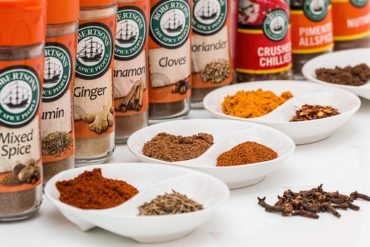 Spice jars organized in a neat row